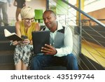 Stock photo two creative millenial small business owners working on social media strategy using a digital 435199744