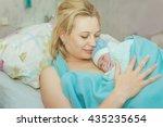 birth  newborn | Shutterstock . vector #435235654