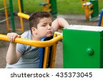 tired sad fat boy sitting on... | Shutterstock . vector #435373045