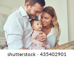 proud mother and father smiling ... | Shutterstock . vector #435402901