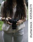 Female Photographer Preparing...