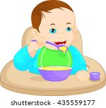 baby boy eating baby food | Shutterstock . vector #435559177