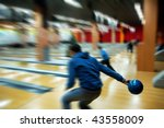 Man bowling, lateral view. Selected focus on ball