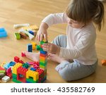 little girl playing with toy... | Shutterstock . vector #435582769