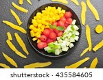 mixed tropical fruit salad... | Shutterstock . vector #435584605