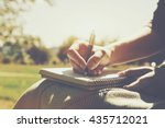girls hands with pen writing on ... | Shutterstock . vector #435712021