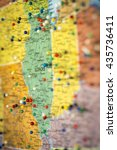 Small photo of Colorful detail map macro close up with push pins marking locations throughout the United States of America IL Illinois IN Indiana