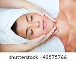beautiful young woman receiving ...   Shutterstock . vector #43575766