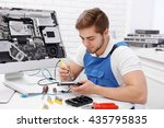 young repairer working with... | Shutterstock . vector #435795835