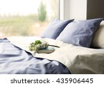 made up bed with blue bed... | Shutterstock . vector #435906445