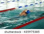 sporty young man swimming in... | Shutterstock . vector #435975385