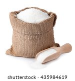 Stock photo sugar in burlap sack with wooden scoop isolated on white background full bag of sugar crystals 435984619