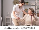 young carer supporting senior... | Shutterstock . vector #435998341