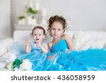 two sisters in blue dresses | Shutterstock . vector #436058959
