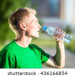 tired man drinking water from a ... | Shutterstock . vector #436166854
