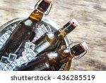 bottles of beer in ice cubes | Shutterstock . vector #436285519