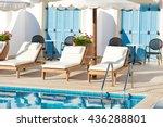Sunbeds And Umbrellas Near The...