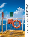 Small photo of Offshore oil and gas wellhead remote platform safety equipment, Buoy with life line and ESD emergency shutdown station at the escape way
