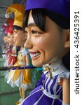 Small photo of ROPPONGI, TOKYO, JAPAN - AUGUST 2015: Exhibition of the popular Japanese girl band Momoiro Clover Z, or Momoclo, in Roppongi Hills - life size dolls of the girls in colorful costumes.