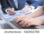 Small photo of Business adviser analyzing financial figures denoting the progress in the work of the company