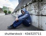 Sad Man Sit Near The Brick Wall