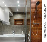 Small photo of Shower with wooden wall as modern design in bathroom