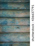 Small photo of a wooden wall covered with stains of blue color with an accentuated texture wood, background, substrate
