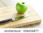 green apple with knife on... | Shutterstock . vector #436656877