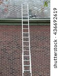 ladder against slate roof with... | Shutterstock . vector #436692619