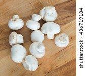 fresh champingons on wooden... | Shutterstock . vector #436719184