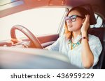 asian woman driving a car | Shutterstock . vector #436959229