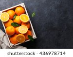 fresh orange fruits in wooden... | Shutterstock . vector #436978714