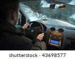 Man Driving Car In Snowed...