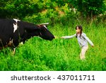 children playing with a cow in... | Shutterstock . vector #437011711