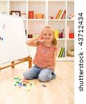 happy little preschool girl... | Shutterstock . vector #43712434