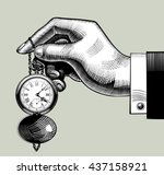 hand with an old clock. retro... | Shutterstock .eps vector #437158921