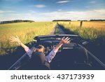 happy women in a cabriolet on... | Shutterstock . vector #437173939