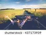 happy women in a cabriolet on... | Shutterstock . vector #437173939