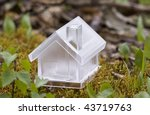 Crystal house over moss - stock photo