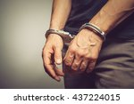 Male Hands In Handcuffs