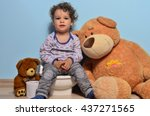 Baby Toddler Sitting On A Pott...