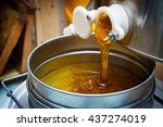 extracting honey by honey... | Shutterstock . vector #437274019