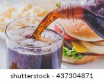 soft drink pouring in a glass... | Shutterstock . vector #437304871
