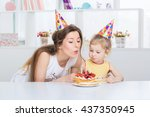 young beautiful mother and her... | Shutterstock . vector #437350945