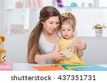 mother with little daughter in... | Shutterstock . vector #437351731