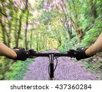 closeup of hands of a mountain biker at high speed on the island of La Palma Canary Islands Spain - stock photo