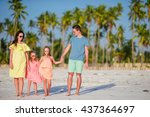 family of four on vacation | Shutterstock . vector #437364697