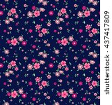 Stock vector cute pattern in small flower small pink flowers dark blue background ditsy floral background 437417809