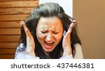 Small photo of Deeply upset and agitated woman. Portrait of screaming woman.