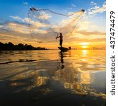 fisherman with net in action ... | Shutterstock . vector #437474479